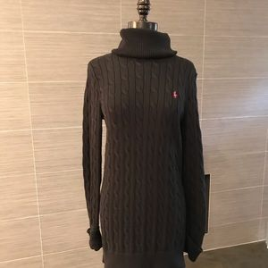 Black turtle neck, tunic sweater.